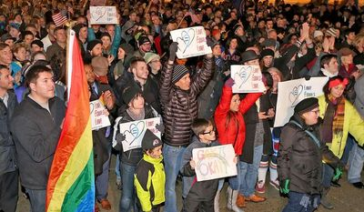 About 1,500 people gather to celebrate marriage equality after a federal judge declined to stay his ruling that legalized same-sex marriage in Utah, at Washington Square just outside of the Salt Lake City and County Building Monday, Dec. 23, 2013, in Salt Lake City. (AP Photo/The Deseret News, Tom Smart)