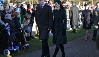 Britain's Prince William, left, accompanied by his wife Kate, Duchess of Cambridge, arrive to attend a Christmas Day Service with other members of the royal family at St. Mary's church on the grounds of Sandringham Estate, the Queen's royal estate, in Norfolk, England, Wednesday, Dec. 25, 2013. (AP Photo/Lefteris Pitarakis)