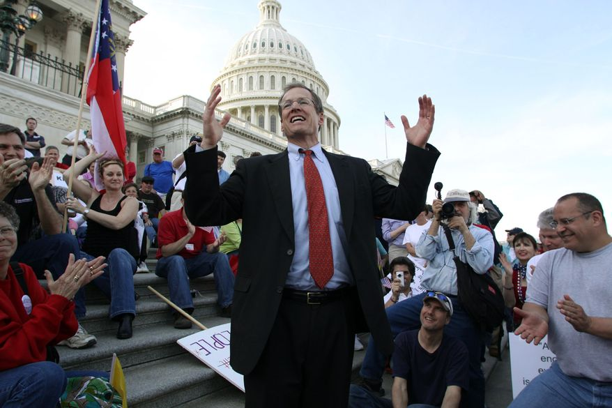 ** FILE ** In this March 20, 2010, file photo, Rep. Jack Kingston, R-Ga., speaks to people demonstrating against the health care bill on the U.S. Capitol steps a day before Congress is set to vote on health care reform on Capitol Hill in Washington. Republicans see the 2014 midterm elections as a chance to capitalize on voter frustration with the problem-plagued health care overhaul, but the GOP first must settle a slate of Senate primaries where conservatives are arguing over the best way to oppose President Barack Obama's signature law. (AP Photo/Lauren Victoria Burke)