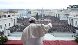 """In this picture provided by the Vatican newspaper L'Osservatore Romano, Pope Francis delivers his """"Urbi et Orbi"""" (to the City and to the World) message from the central balcony of St. Peter's Basilica at the Vatican, Wednesday, Dec. 25, 2013. Pope Francis on Christmas day is wishing for a better world, with peace for the land of Jesus' birth, for Syria and Africa as well as for the dignity of migrants and refugees fleeing misery and conflict. Francis spoke from the central balcony of St. Peter's Basilica Wednesday to tens of thousands of tourists, pilgrims and Romans in the square below. He said he was joining in the song of Christmas angels with all those hoping """"for a better world,"""" and with those who """"care for others, humbly."""" (AP Photo/L'Osservatore Romano, ho)"""