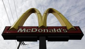 FILE - In this Friday, Oct. 4, 2013, file photo, a McDonald's restaurant sign is seen at a McDonald's restaurant in Chicago. McDonald's Corp. has shut down a website, Thursday, Dec. 26, 2013, intended to provide employees with work and life guidance after it generated negative publicity for the fast-food company. (AP Photo/Nam Y. Huh, File)