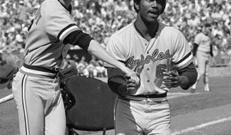 FILE - In this Oct. 5, 1974, photo, Baltimore Orioles' Paul Blair is greeted at the plate after a home run in the opening game against the Oakland Athletics in the American League baseball playoffs in Oakland, Calif. Blair, the eight-time Gold Glove center fielder who helped the Orioles win World Series titles in 1966 and 1970, has died. He was 69. Blair died Thursday night, Dec. 26, 2013, at Sinai Hospital of Baltimore, according to a hospital spokeswoman. (AP Photo)