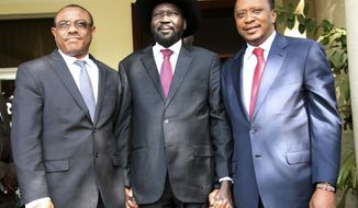 In this photo released by the Kenyan Presidential Press Service, Ethiopian Prime Minister Hailemariam Desalegn, left, South Sudanese President Salva Kiir, center, and Kenyan President Uhuru Kenyatta, right, pose for a photos before their meeting at State House in Juba, South Sudan, Thursday, Dec. 26, 2013. The leaders of Kenya and Ethiopia arrived in South Sudan on Thursday to try and mediate between the country's president and the political rivals he accuses of attempting a coup that the government insists sparked violence threatening to destroy the world's newest country. (AP Photo/Kenyan Presidential Press Service)