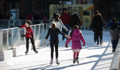 Children and adults glide across the ice skating rink during a holiday break from school at Washington Canal Park, in Washington, DC., Thursday, December 25, 2013.  (Andrew S Geraci/The Washington Times)