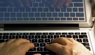 ** FILE ** In this Wednesday, Feb. 27, 2013, photo illustration, hands type on a computer keyboard in Los Angeles. (AP Photo/Damian Dovarganes, File)