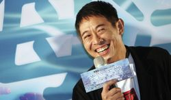 """FILE - In this Monday, Aug. 23, 2010 file photo, Chinese actor Jet Li smiles during a press event for announcing his new movie """"Ocean Heaven,"""" in Taipei, Taiwan. Li said he's being treated for an overactive thyroid, but he's determined to fight the condition head-on. (AP Photo/Chiang Ying-ying, File)"""