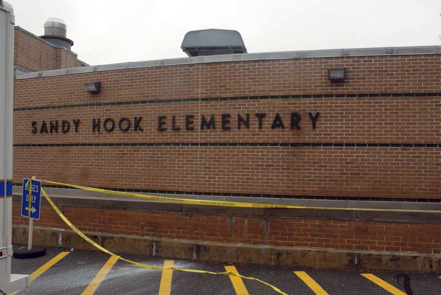 ** FILE ** This December 2012 photo released by the Connecticut State Police on Friday, Dec. 27, 2013, shows a scene at Sandy Hook Elementary School in Newtown, Conn. (AP Photo/Connecticut State Police)