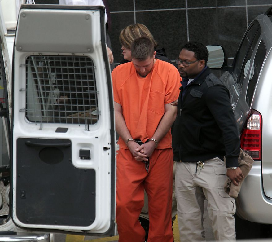 """Conrad Alvin Barrett, 27, is escorted out of the Bob Casey Federal Courthouse Friday, Dec. 27,2 013, in Houston. Barrett was arrested the day before on federal hate crimes charges for allegedly shooting video of himself sucker-punching a 79-year-old black man in a """"knockout game""""-style attack. According to prosecutors, the attack happened Nov. 24 in Katy, but it wasn't until 12 days later that authorities connected the attack to the cellphone video of it. (AP Photo/Houston Chronicle, James Nielsen) MANDATORY CREDIT"""