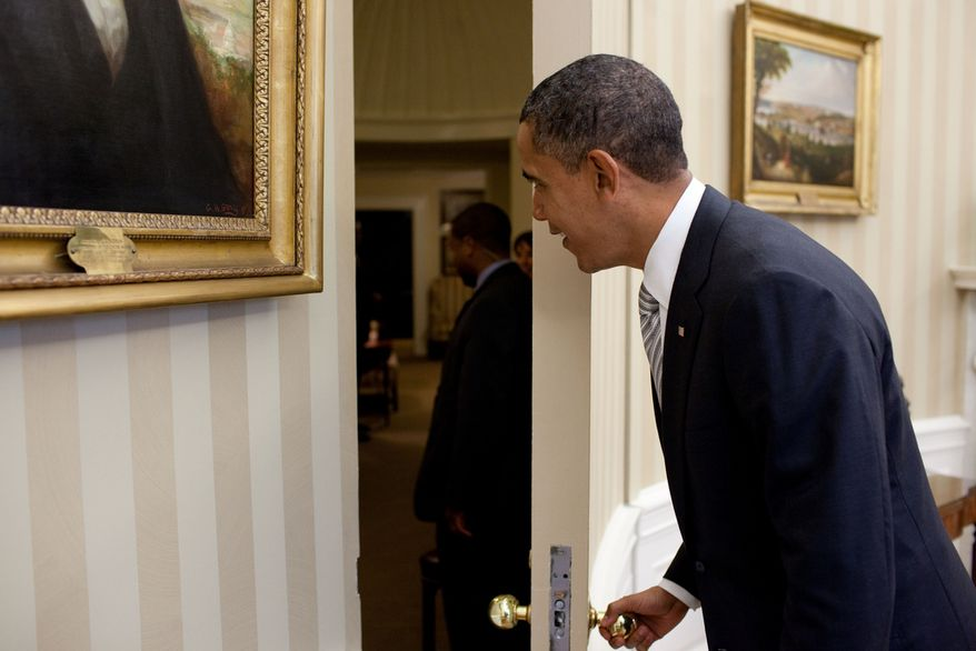 """President Barack Obama opens a door in the Oval Office to greet children from the education documentary """"Waiting for Superman,"""" Oct. 11, 2010. (Official White House Photo by Pete Souza)"""