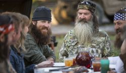 """** FILE ** This undated image released by A&E shows Phil Robertson, flanked by his sons Jase Robertson, left, and Willie Robertson from the popular series """"Duck Dynasty."""" (AP Photo/A&E, Zach Dilgard)"""