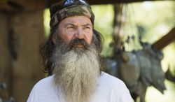 """Phil Robertson from the popular A&E series """"Duck Dynasty"""" was suspended in December for disparaging comments he made to GQ magazine about gay people but was reinstated by the network in response to a popular backlash. (AP Photo/A&E, Zach Dilgard)"""