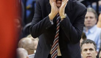 Washington Wizards coach Randy Wittman yells instructions to his team during the second half of an NBA basketball game against the Minnesota Timberwolves, Friday, Dec. 27, 2013, in Minneapolis. The Timberwolves won 120-98. (AP Photo/Jim Mone)