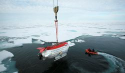 Chilling: In 2007, explorers in the oil-rich Arctic dropped two miniature submarines more than 2 miles beneath the ice at the North Pole to plant a Russian flag on the ocean floor. (Associated Press)