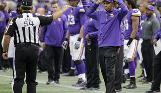 Minnesota Vikings head coach Leslie Frazier, right, disagrees with a call during the second half of an NFL football game against the Detroit Lions, Sunday, Dec. 29, 2013, in Minneapolis. (AP Photo/Ann Heisenfelt)