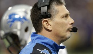 Detroit Lions head coach Jim Schwartz stands on the sidelines during the second half of an NFL football game against the Minnesota Vikings, Sunday, Dec. 29, 2013, in Minneapolis. The Vikings won 14-13.  (AP Photo/Jim Mone)