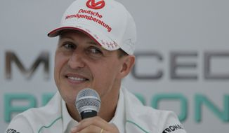 "File - Michael Schumacher announces his retirement from Formula One at the end of the 2012 season during a press conference at the Suzuka Circuit venue for the Japanese Formula One Grand Prix in Suzuka, Japan, in this Thursday, Oct. 4, 2012 file photo. Seven-time Formula One champion Michael Schumacher was hospitalized with a head injury Sunday Dec. 29 2013, after a skiing accident in the French Alps, French authorities and his manager said. The French Mountain Gendarmerie said Schumacher was wearing a helmet when he had a hard fall at the Meribel resort and that he sustained a ""relatively serious"" head injury.  (AP Photo/Itsuo Inouye, file)"