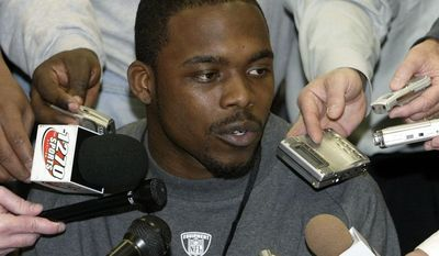 Virgina Tech's Marcus Vick answers a question from the media at the NFL combine, Friday, Feb. 24, 2006 in Indianapolis. (AP Photo/John Harrell)