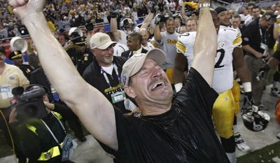 ** FILE ** Pittsburgh Steelers head coach Bill Cowher reacts after being doused with water after the team's 21-10 win over the Seattle Seahawks in the Super Bowl XL football game in Detroit, in this Feb. 5, 2006 file photo. (AP Photo/Gene J. Puskar, File)