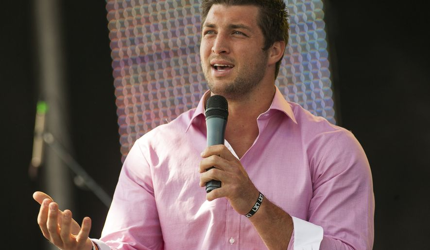 New York Jets quarterback Tim Tebow speaks at the Easter service of Celebration Church in Georgetown, Texas, Sunday, April 8, 2012. (AP Photo/William Philpott)