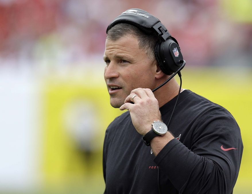 FILE - In a Sunday, Dec. 15, 2013 file photo, Tampa Bay Buccaneers head coach Greg Schiano watches during the first quarter of an NFL football game against the San Francisco 49ers, in Tampa, Fla. The Tampa Bay Buccaneers announced Monday, Dec. 30, 2013 that they have fired coach Greg Schiano and general manager Mark Dominik following a 4-12 finish. (AP Photo/Chris O'Meara, File)