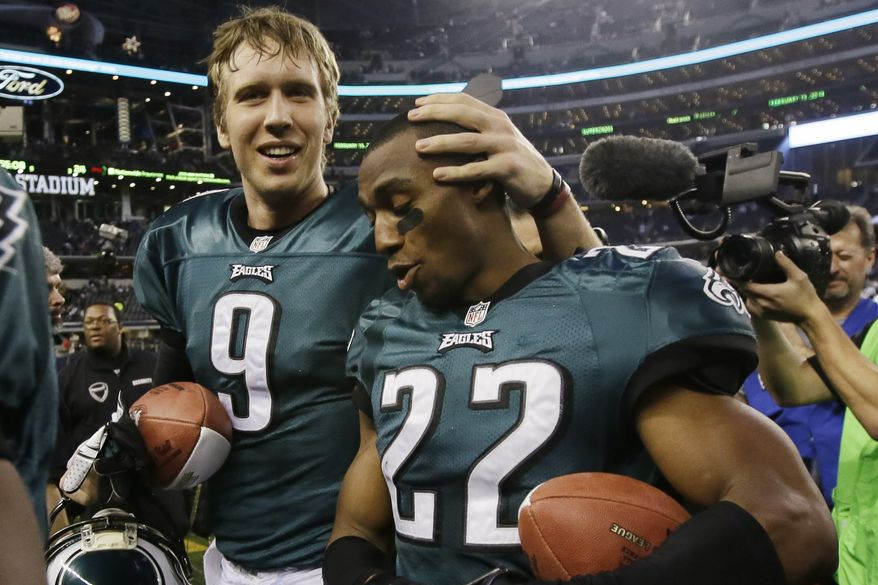 Philadelphia Eagles quarterback Nick Foles (9) and cornerback Brandon Boykin (22) leave the field after an NFL football game against the Dallas Cowboys, Sunday, Dec. 29, 2013, in Arlington, Texas. The Eagles won 24-22. (AP Photo/Tony Gutierrez)