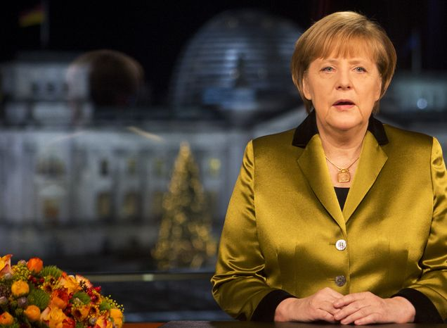** FILE ** German Chancellor Angela Merkel poses for a photograph after the recording of her annual New Year's speech at the Chancellery in Berlin, Germany, Monday, Dec. 30, 2013. (AP Photo/David Gannon, Pool)