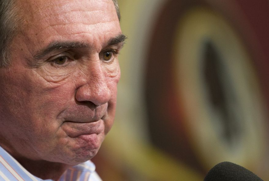Former Washington Redskins head coach Mike Shanahan delivers a statement at an NFL football news conference after being fired, Monday, Dec. 30, 2013, in Ashburn, Va. Shanahan was fired after a morning meeting with owner Dan Snyder and general manager Bruce Allen at Redskins Park, a formality expected for several weeks as the losses mounted and tension rose among Shanahan, Snyder and franchise player Robert Griffin III. (AP Photo/ Evan Vucci)