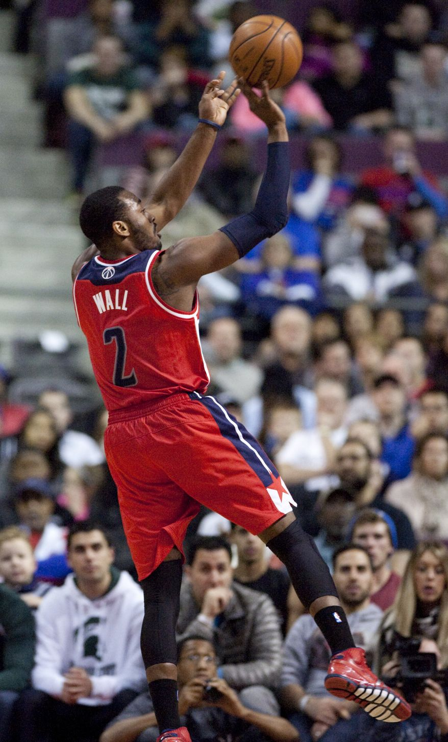Washington Wizards guard John Wall (2) takes a shot against the Detroit Pistons during the second half of an NBA basketball game, Monday, Dec. 30, 2013, in Auburn Hills, Mich. Wall led the Wizards with 29 points in a 106-99 win. (AP Photo/Duane Burleson)