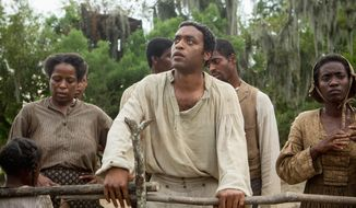 "Actor Chiwetel Ejiofor (center) was nominated for a Golden Globe for his performance in ""12 Years A Slave."" (Associated Press)"
