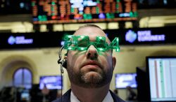 A trader on the floor at the New York Stock Exchange gets into the New Year's spirit during an abbreviated trading session, capping a stellar year for U.S. stock markets. (associated press)