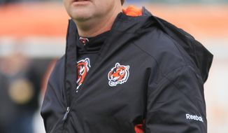 Cincinnati Bengals offensive coordinator Jay Gruden walks on the field prior to an NFL football game against the Baltimore Ravens, Sunday, Jan. 1, 2012, in Cincinnati. (AP Photo/Al Behrman)