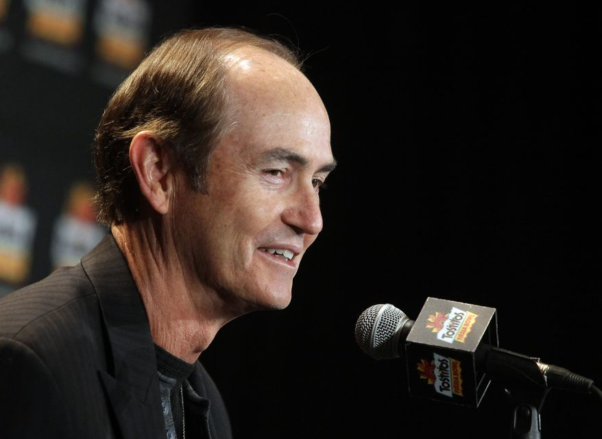 Baylor head coach Art Briles acknowledges the media during and NCAA college football news conference, Tuesday, Dec. 31, 2013, in Scottsdale, Ariz. Baylor plays Central Florida at the Fiesta Bowl on New Year's Day in Glendale, Ariz.. (AP Photo/Rick Scuteri)
