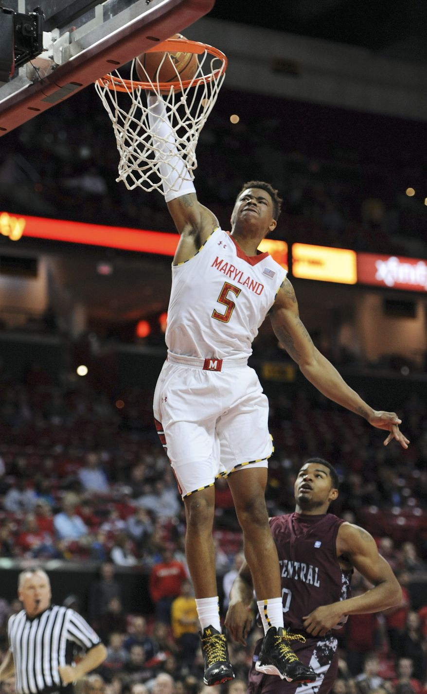 Maryland's Nick Faust dunks the ball to score against North Carolina Central in the second half of an NCAA college basketball game Tuesday, Dec. 31, 2013, in College Park, Md. Maryland won 70-56.(AP Photo/Gail Burton)