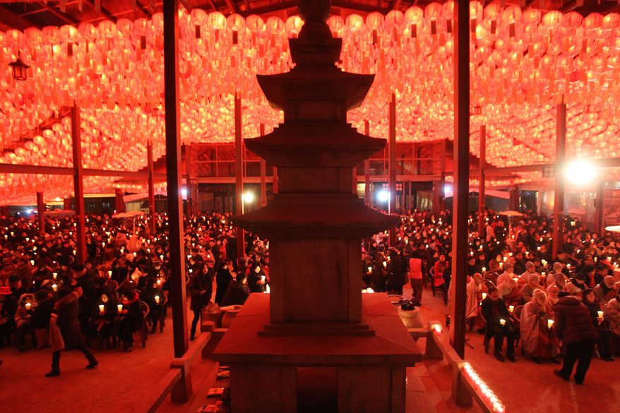 Buddhists attend New Year's Eve celebrations at the Bongeun Buddhist temple in Seoul, South Korea, Wednesday, Jan. 1, 2014. (AP Photo/Ahn Young-joon)