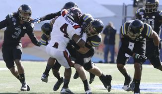 UCLA defenders team up to stop Virginia Tech's J.C. Coleman during the second quarter of the Sun Bowl NCAA college football game Tuesday, Dec. 31, 2013, in El Paso, Texas. (AP Photo/Victor Calzada)