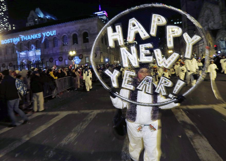 Marchers make their way down Boylston Street during a parade as part of New Year's Eve celebrations in Boston, Tuesday, Dec. 31, 2013. (AP Photo/Michael Dwyer)