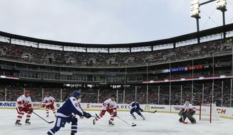 Toronto Maple Leafs' Dan Daoust scores a goal on Detroit Red Wings goalie Kevin Hodson  during the first period of the Winter Classic Alumni outdoor NHL hockey game at Comerica Park in Detroit, Tuesday, Dec. 31, 2013. (AP Photo/Carlos Osorio)