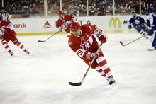 Detroit Red Wings forward Steve Yzerman skates during the second period of the Winter Classic Alumni outdoor NHL hockey game against the Toronto Maple Leafs at Comerica Park in Detroit, Tuesday, Dec. 31, 2013. (AP Photo/Carlos Osorio)