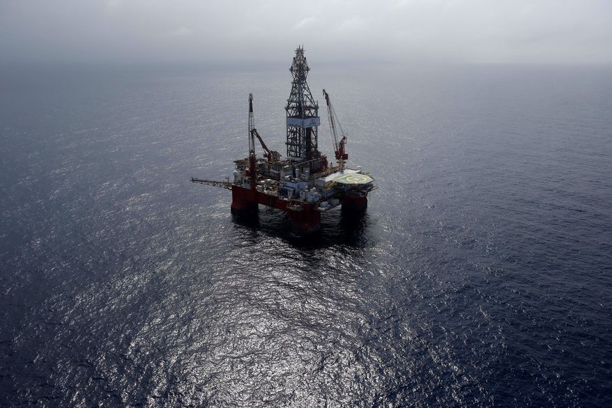 The Centenario deep-water drilling platform stands off the coast of Veracruz, Mexico in the Gulf of Mexico, Friday, Nov. 22, 2013. The administration of Mexico's President Enrique Pena Nieto is pushing for an energy reform that will increase private investment in state-owned oil company Pemex and Mexicos oil industry as traditional easy oil reserves dry up, forcing the country to explore deep water and shale oil that are more expensive and complicated to extract. (AP Photo/Dario Lopez-Mills)