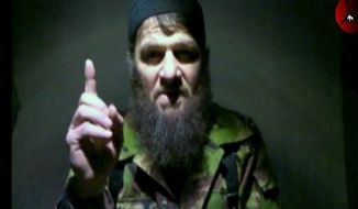 Specially designated: Doku Umarov circulated a video last summer advocating action against the Winter Olympics in Russia. (Kavkaz Center via Associated Press)