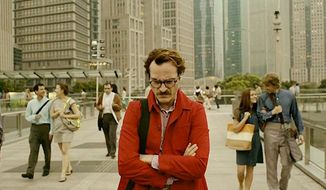 "Joaquin Phoenix in the movie ""Her."""