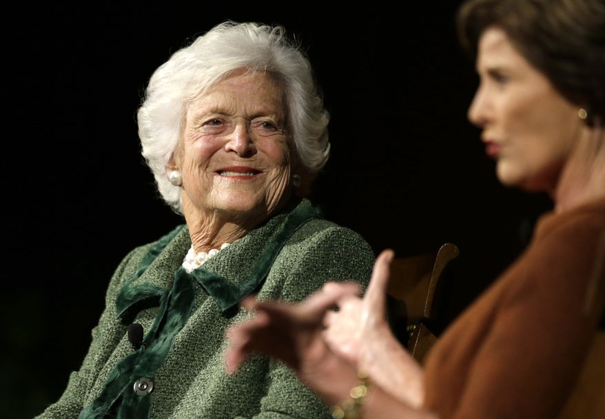 Former first ladies Barbara Bush, left, and Laura Bush, take part in the Enduring Legacies of America's First Ladies conference Thursday, Nov. 15, 2012, in Austin, Texas. Family members, former staff members, historians, and White House insiders were also spoke as part of the program. (AP Photo/David J. Phillip)
