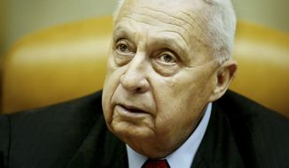 ** FILE ** In this Sunday Jan. 30, 2005, file photo, then-Israeli Prime Minister Ariel Sharon pauses during the weekly cabinet meeting in his Jerusalem office. On Wednesday, Jan. 1, 2014, the condition of the comatose former Israeli Prime Minister Ariel Sharon has taken a turn for the worse, the hospital treating him said. (AP Photo/Oded Balilty, Pool, File)