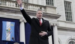 New York City Mayor Bill de Blasio waves after being sworn in during the public inauguration ceremony at City Hall in New York, Wednesday, Jan. 1, 2014. (AP Photo/Seth Wenig)