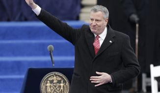 New York Mayor Bill de Blasio waves after taking the oath of office in on the steps of City Hall Wednesday, Jan. 1, 2014, in New York. (AP Photo/Frank Franklin II)