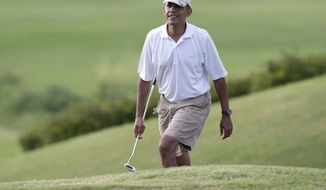 President Barack Obama smiles as he walks onto the 18th green at Mid-Pacific County Club in Kailua, Hawaii, Wednesday, Jan. 1, 2014, as he golfs with Marty Nesbitt, Bobby Titcomb, Sam Kass, Marvin Nicholson, and Andrew Dibble. The first family is in Hawaii for their annual holiday vacation.  (AP Photo/Carolyn Kaster)