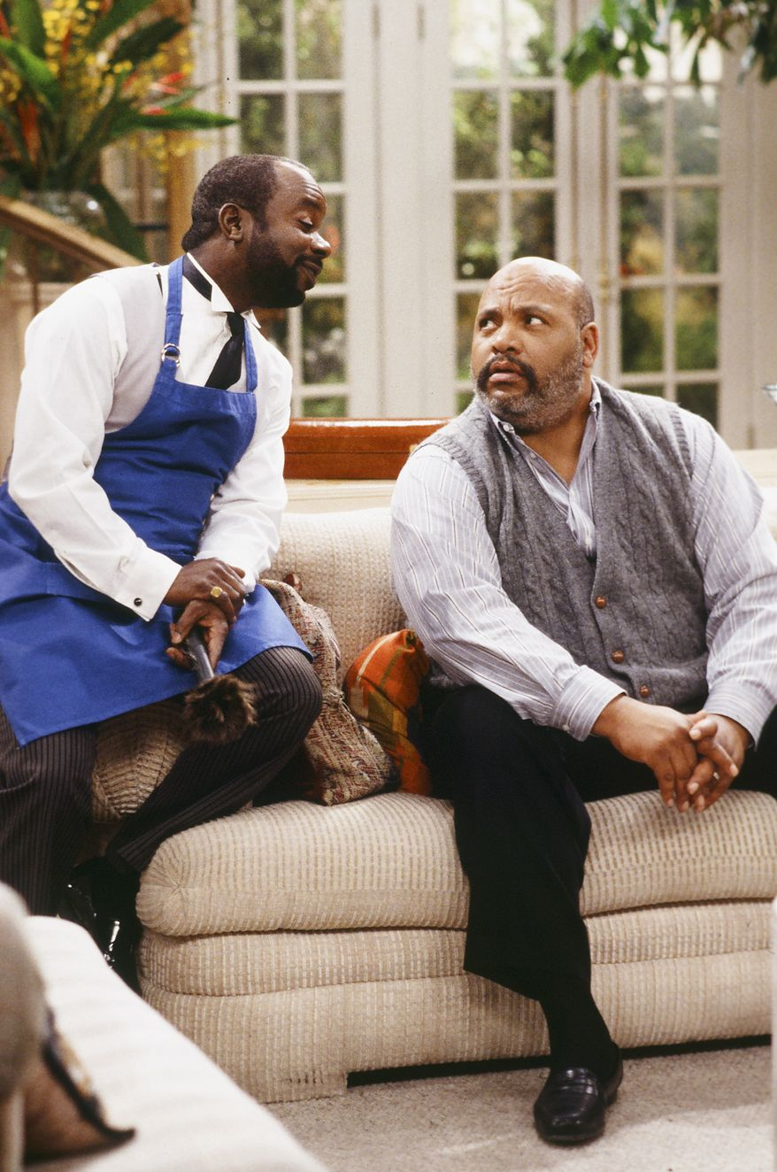 """This photo provided by NBC shows, Joseph Marcell, left, as Geoffrey, and James Avery, as Philip Banks, in the episode """"Papa's Got a Brand New Excuse"""" from the TV series, """"The Fresh Prince of Bel-Air."""" Avery, 65, the bulky character actor who laid down the law as the Honorable Philip Banks has died. Avery's publicist, Cynthia Snyder, told The Associated Press that Avery died Tuesday, Dec. 31, 2013. (AP Photo/NBC, Margaret Norton)"""