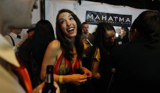 "Errin Reaume laughs during a Prohibition-era themed New Year's Eve party celebrating the start of retail marijuana sales, at a bar in Denver, late Tuesday Dec. 31, 2013. Colorado is to begin marijuana retail sales on Jan. 1, a day some are calling ""Green Wednesday."" ""Honestly, I thought I'd never see the day,"" said Reaume. (AP Photo/Brennan Linsley)"