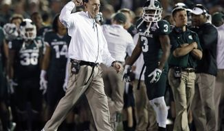 Michigan State coach Mark Dantonio,reacts to a play during the second half of the Rose Bowl NCAA college football game against Stanford on Wednesday, Jan. 1, 2014, in Pasadena, Calif. Michigan State won 24-20. (AP Photo/Danny Moloshok)