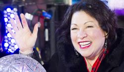 U.S. Supreme Court Justice Sonia Sotomayor pushes the Waterford crystal button that signals the descent of the New Year's Eve Ball in Times Square on Tuesday, Dec. 31, 2013 in New York. (Photo by Charles Sykes/Invision/AP)